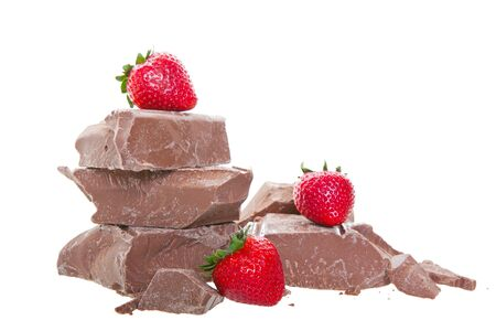 Fresh, mouth-watering, strawberries on top of thick chunks of milk chocolate   Shot on white background  photo