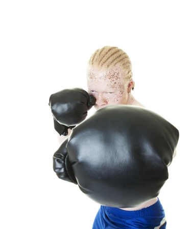 An albino African-American boxer throws a punch towards the camera