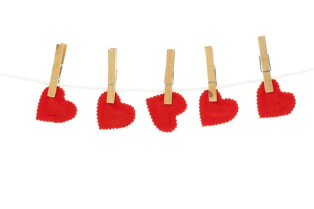 Homemade felt hearts hanging on a clothesline   Shot on white background  photo