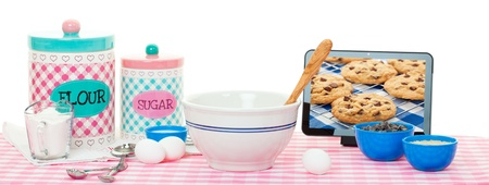 Baking using a tablet with recipe app   photo