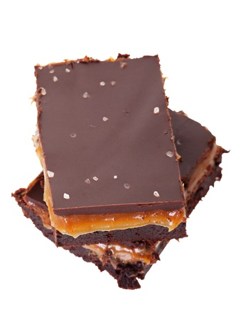 Rich, gooey good salted chocolate caramel brownies   Shot on white background  Stock Photo