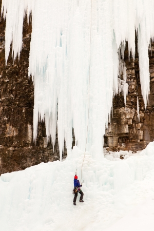 banff: An Ice Climber climbing the Upper Ice Falls in Johnson Canyon   Located in Banff National Park, Alberta, Canada