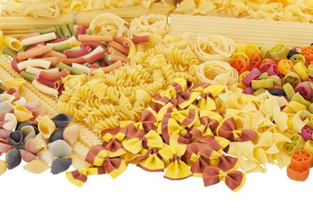 A variety of different dry pastas   Shot on white background  photo