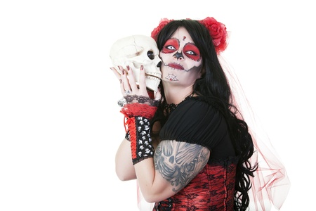 sugar veil: A woman dressed as a sugar skull holding the skull