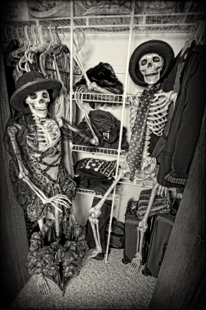 closet: Two skeletons enjoying themselves in someones closet.  Grain intended. Stock Photo