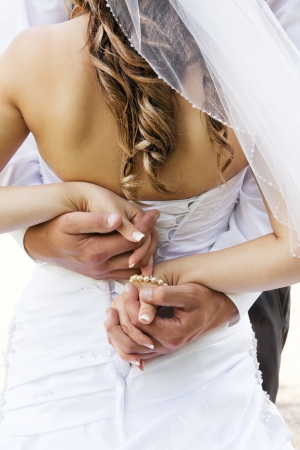 Wedding couple holding hands and hugging. Stock Photo