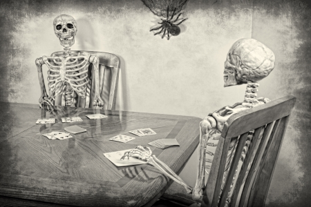 rummy: Two skeletons playing a game of rummy.  Halloween theme. Textured.