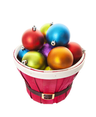 A belted santa basket bulging with a multitude of colorful Christmas balls Stock Photo