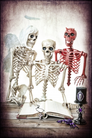 A skeleton man being coaxed by his good and bad side.  Classic good versus evil.
