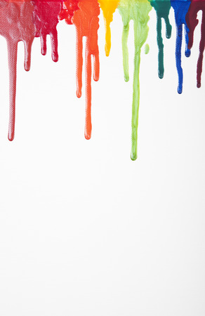 Brightly colored nail enamel dripping down white canvas.