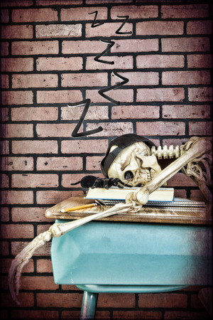 Passed out: A skeleton student catches some ZZZ