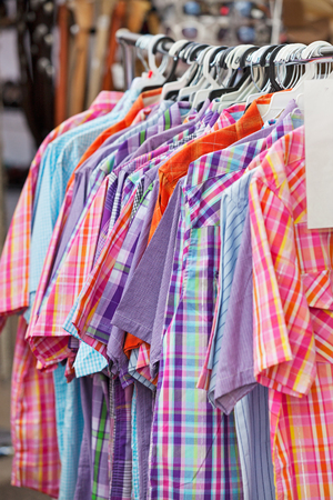 stampede: A rack of ladies Western shirts for sale at the Calgary Stampede
