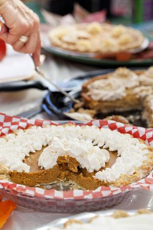 Several Pumpkin Pies in a pumpkin pie tasting contest.