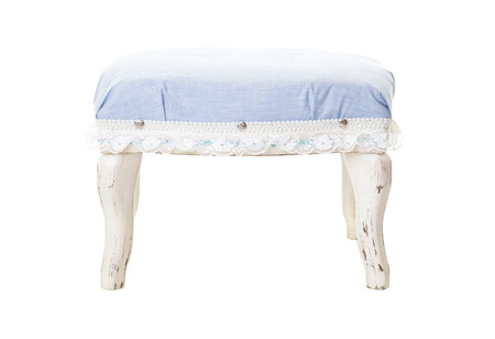 White rustic stool with a cotton denim padded seat, trimmed with lace. Shot on white background.