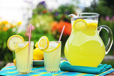 Thirst-quenching lemonade served outside in a beautifully landscaped backyard.
