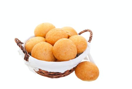 A fresh basket of golden brown hard crusted buns.  Shot on white background. Imagens