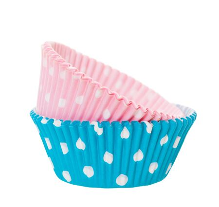 Pink and blue cupcake wrappers with white polka-dots on a white background.  Boy and girl theme.