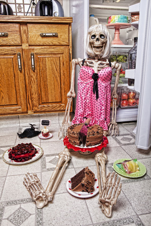 red velvet cupcake:  skeleton of woman in a kitchen