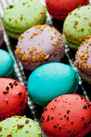 dramatically: Freshly made macaroons dramatically backlit to show off the textures. Stock Photo