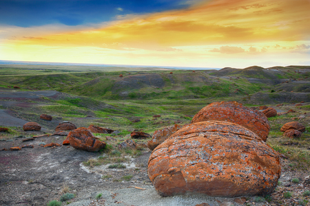 An evening landscape shot at Red Rock Coulee.  The most striking features of this landscape are the round reddish, prehistoric boulders. These are sandstone concretions and at up to 2.5 m in diameter, they are among the largest in the world.