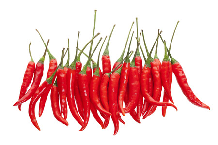 A bunch of red hot chili peppers shot from above on white background. Imagens