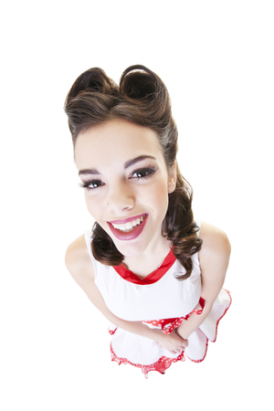 Happy, smiling, pinup girl with hair in victory rolls.  Shot on white background. Imagens