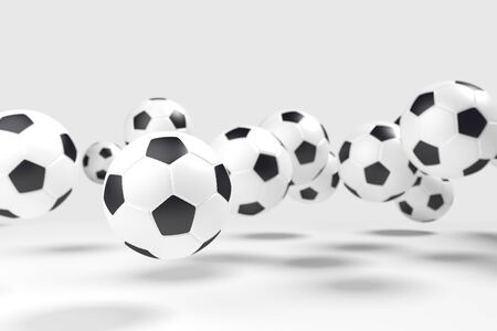 levitation: Levitation of the soccer balls football in front of the light-gray background. The light-gray background isolate the balls from the background. Focus to the nearest ball. Stock Photo