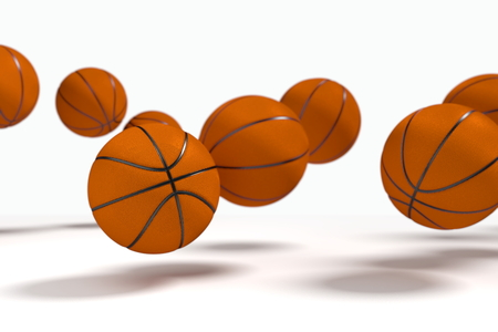 basketballs: Levitation of the basketballs in front of the white background. Focus to the nearest ball. Stock Photo