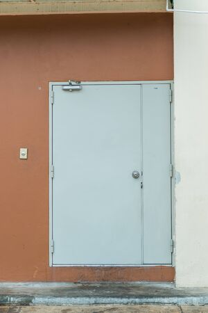 wood molding: white door on a brown wall Stock Photo