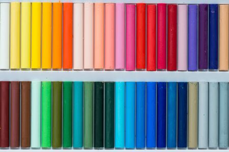 oil color: Colorful oil pastels in a box, close up, macro, full frame Stock Photo