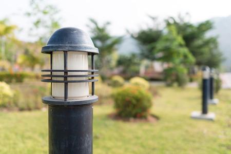 outdoor lighting: Lighting equipment. Modern outdoor lawn lamp. Decorative garden lamp for landscape lighting.