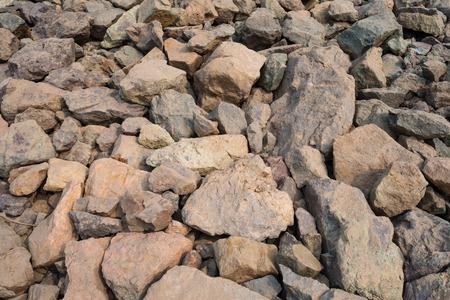 obrero: piedra natural gris en el fondo de la presa Foto de archivo