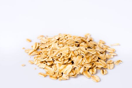 rolled oats: Rolled oats (oat flakes) on white background. Close-up. Foto de archivo