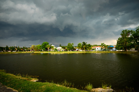 strom: heavy strom clouds raining incoming over lake garden, dramatic