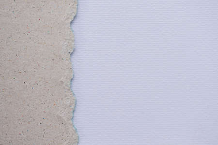 teared paper: Teared, ripped brown paper on white background Stock Photo