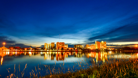 city park skyline: city at night with reflection of skyline in the lake, view in city park Stock Photo
