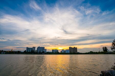 city park skyline: city skyline reflected in lake in nong prajak park, udonthani, Thailand