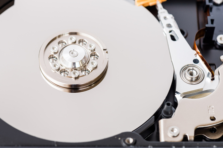 device disc: Close-up view of an opened computer hard disc drive, non-volatile storage device Stock Photo