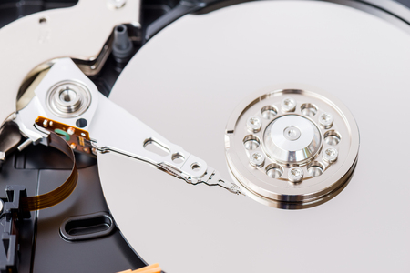 Close-up view of an opened computer hard disc drive, non-volatile storage device Stock Photo