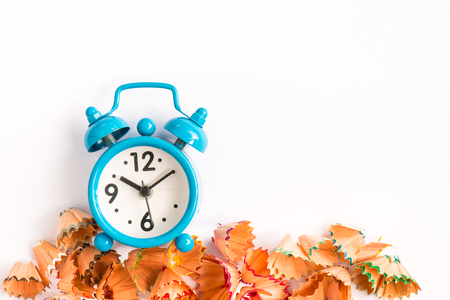 watch groups: Alarm clock with shaving on white background