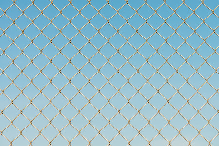 chainlink fence: Close-up of metal wire fence on a blue sky background