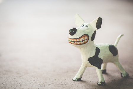Models of a white dog, made from paper mache
