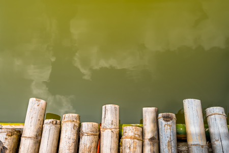 Bamboo raft heading on lake with water background