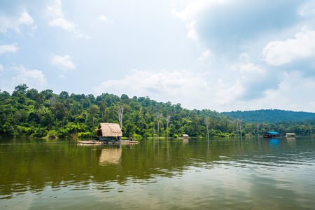 Bamboo raft floating in lake with mountain background