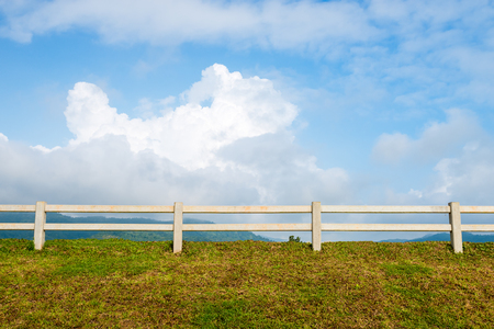 farm fence and blue sky with cloud background
