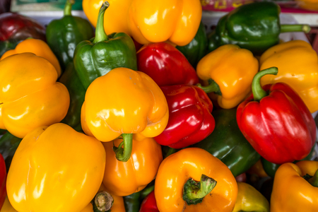 red yellow and green bell pepper in basket