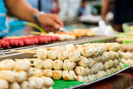immediate: Thai meat ball and sausage with bamboo stick, Thai food on street food prepared or cooked food sold by vendors in a street or other public location for immediate consumption