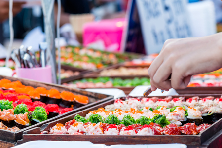 immediate: sushi on street food, prepared or cooked food sold by vendors in a street or other public location for immediate consumption