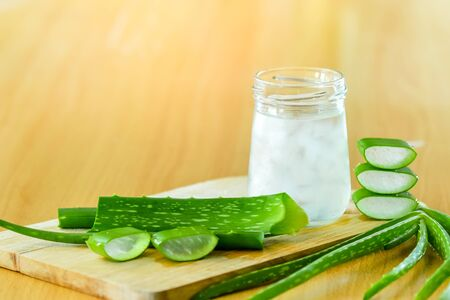 fresh aloe vera leaves and glass of aloe vera juice on wooden background Stock Photo
