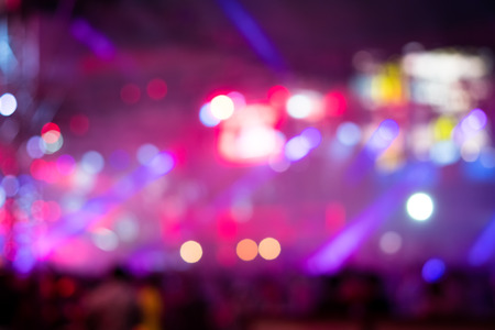 Multicolored stage lighting with Silhouette people, blurred or defocused